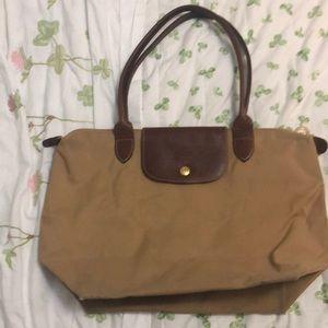 Lightly used longchamp bag medium sized
